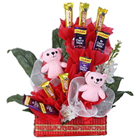 Delectable Collection of Cadbury Chocolates with Pink Teddies in a Basket