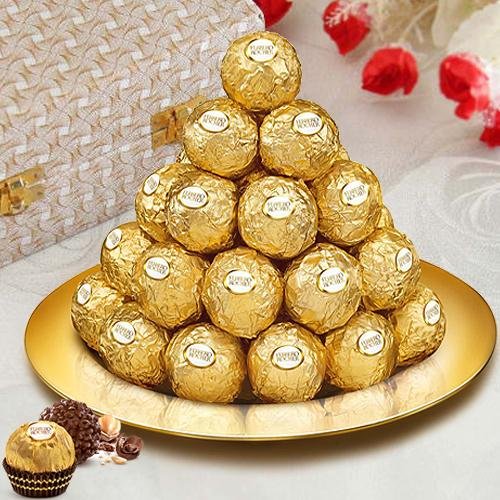 Display of Ferrero Rocher Chocolates in a Golden Plated Thali