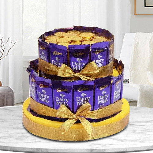 Irresistible Tower Arrangement of Cadbury Dairy Milk with Gold Coin Chocolates