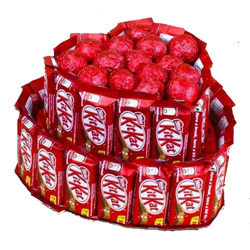 Enjoyable Heart Shape Arrangement of Nestle Kitkat n Assorted Handmade Chocolates