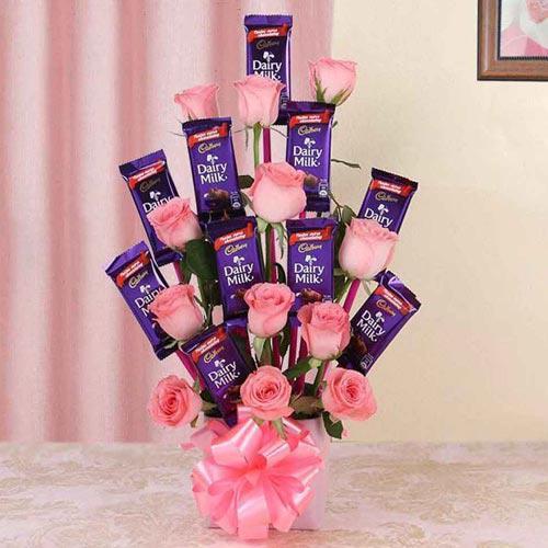 Marvelous Arrangement of Roses with Cadbury Dairy Milk Chocolates