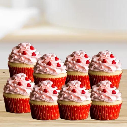 Delicious Vanilla Cup Cakes with Strawberry Topping