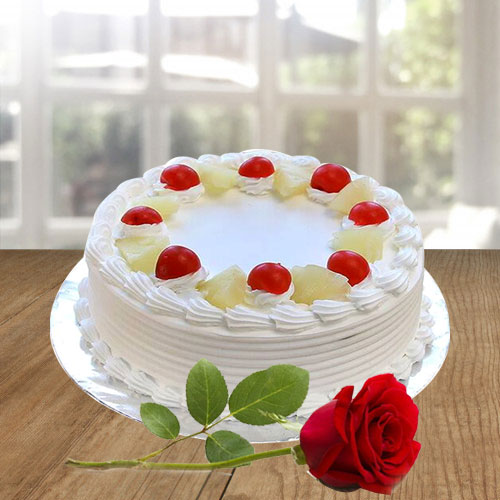 Elegant Vanilla Cake and a Fresh Red Rose