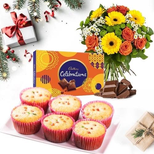 Wholesome X-mas Present of Muffins with Chocolates n Flowers Bouquet