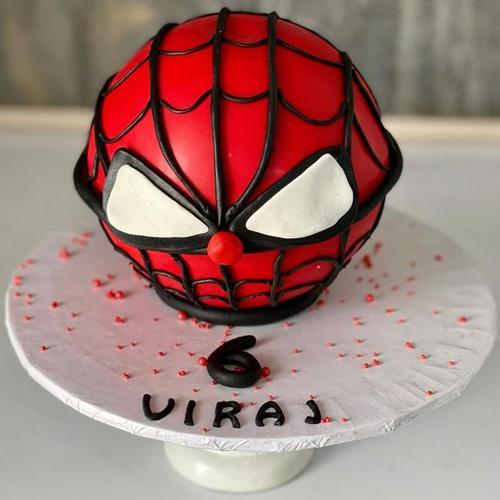 Remarkable Spider Man Round Piñata Cake