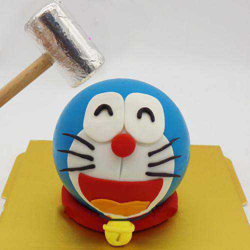 Mouth-Watering Doremon Pinata Cake with Hammer