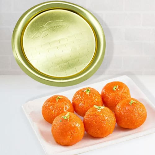 Delectable Haldirams Ladoo with Golden Plated Thali