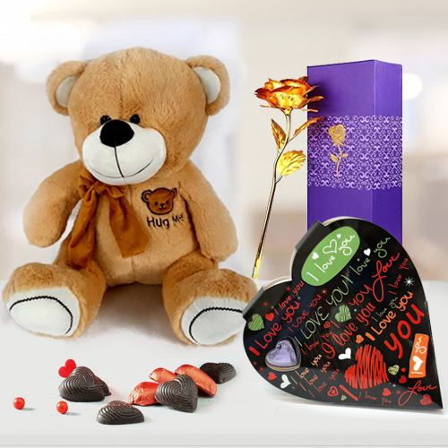 Flattering Gift of Hug Me Teddy with Heart Chocolate n Golden Rose for your Valentine