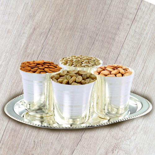 Crunchy mixed Dry Fruits with Silver  Glasses and Tray