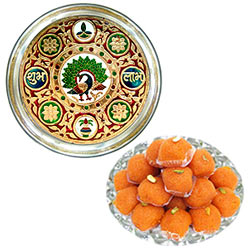 Delicious Haldirams Laddoo along with Subh Labh Stainless Steel Thali