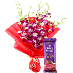 Adorable Bouquet of Orchids and Cadbury Dairy Milk Silk