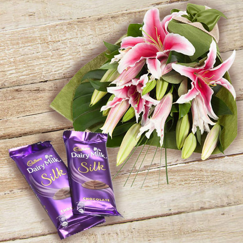 Enjoyable Dairy Milk Silk and Bouquet of Pink Lilies Combo for Anniversary