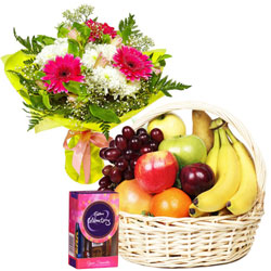 Brilliant Flowers Bouquet with Mixed Fruits Basket and a Chocolate Pack