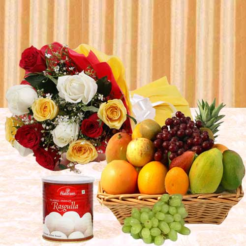 Delicious Pack of Haldirams Rasgulla with Fruits Basket and Roses Bouquet