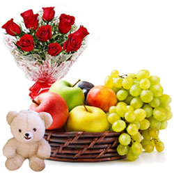 Exclusive Gift of Cute Teddy with Red Roses Arrangement and Mixed Fruits Basket