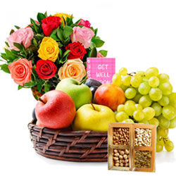 Exclusive Gift of Assorted Fruits Basket with Dry Fruits N Flowers Arrangement