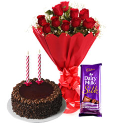 Classic Mid-night Combo of Tasty Cadbury Dairy Milk Silk, Chocolate Cake with candles and Red Roses Bouquet