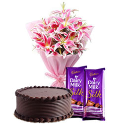 Midnight Present of Delectable Dairy Milk Silk with Lilies Bouquet and Luscious Chocolate Cake