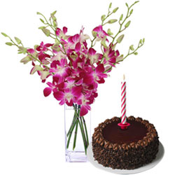 Midnight Combo of Attractive Orchids in Vase with Yummy Chocolate Cake and Candles