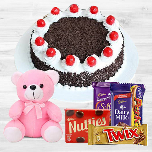 Lavish Black Forest Cake with Assorted Cadburys Chocolate and a Small Teddy