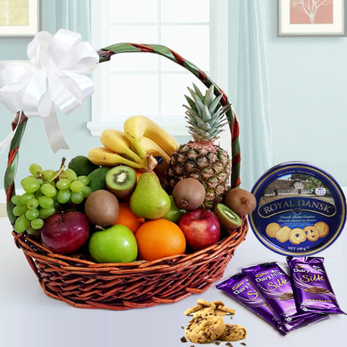 Delectable Fresh Fruits Basket with Danish Cookies N Chocolates