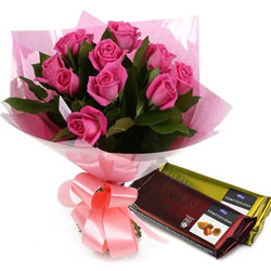 Beautiful Composition of Pink Roses with Chocolates