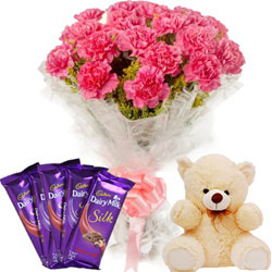 Blossoming Display of Carnations with Chocolates N Teddy-bear