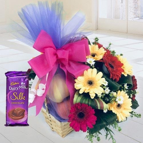 Gorgeous Fruit N Floral Basket with Dairy Milk Silk