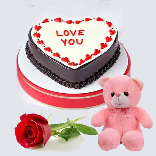 Exciting Gift of Chocolaty Heart Shape Cake with Sweet Teddy N Red Rose