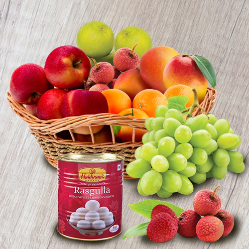 Succulent Fresh Fruits Basket with Haldirams Rasgulla