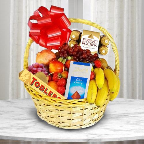 Enticing Basket of Fresh Fruits N Chocolates