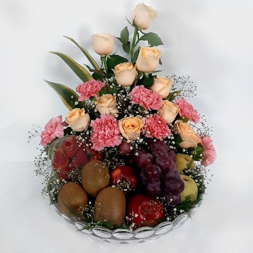 Mother-Natures Exotic Fruits in Glass Vase with Flowers