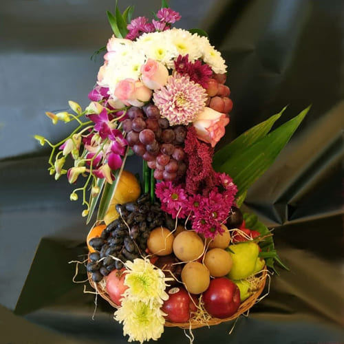 Attractive Tall Arrangement of Flowers n Fruits