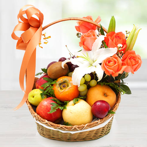 Luscious Imported Fruits Basket with Orange Roses n White Lily