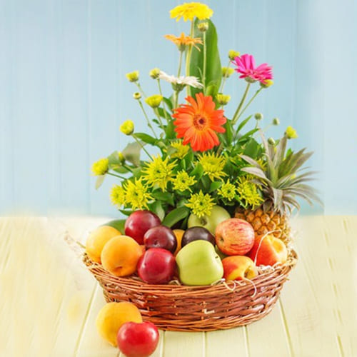 Luxurious Fresh Fruits with Gerberas Gift Basket