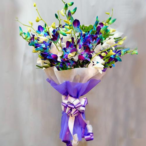 Elegant Bouquet of Blue n White Orchids with Tissue Wrapping