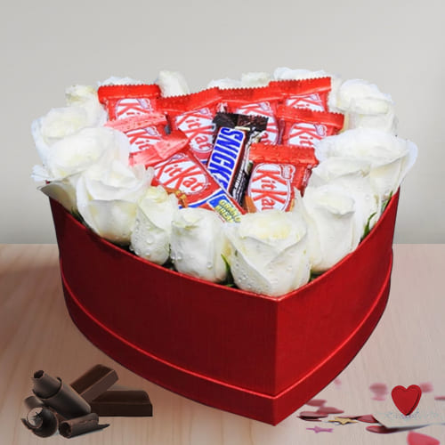 Captivating Arrangement of White Roses N Chocolate in Heart Box
