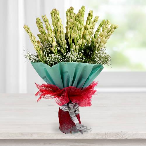 Designer Hand Bouquet of Rajnigandha with Tissue Wrapping