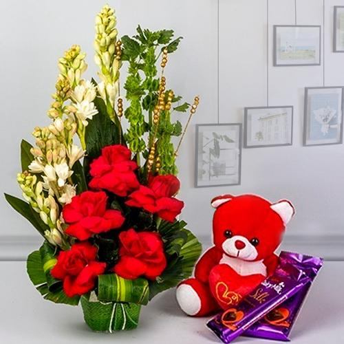 Mesmerizing Fresh Flowers with Teddy n Cadbury Chocolates Gift Combo