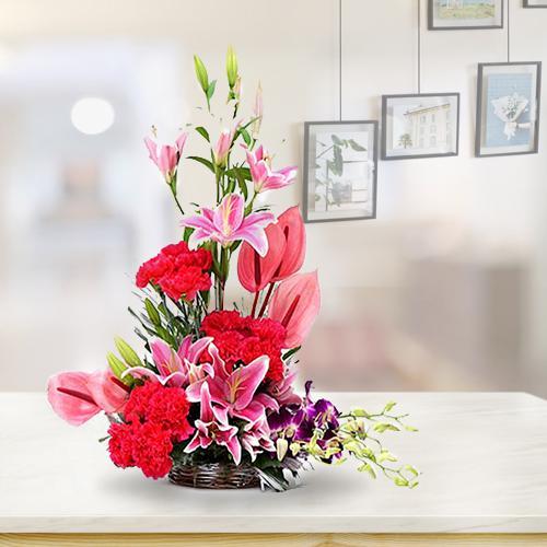 Exclusive Pink Anthodium N Cala Lilies Arrangement