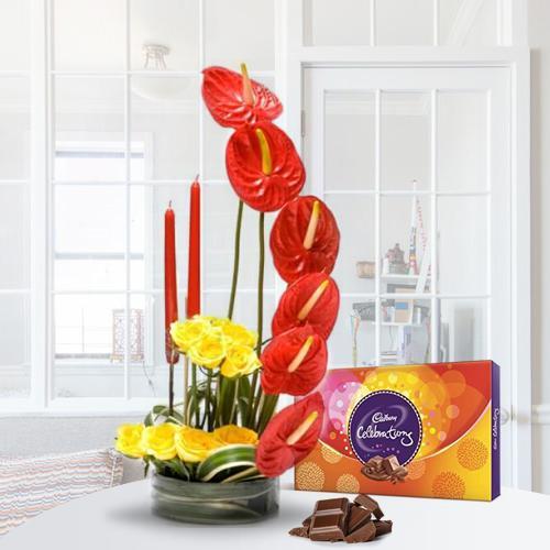 Alluring Flower Arrangement with Candles n Cadbury Celebration