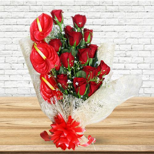 Mesmerizing Bunch of Red Roses N Anthodium with Tissue Wrap