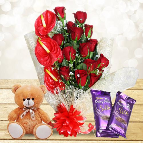 Radiant Selection of Red Flowers Bouquet with Sweet Teddy n Chocolates