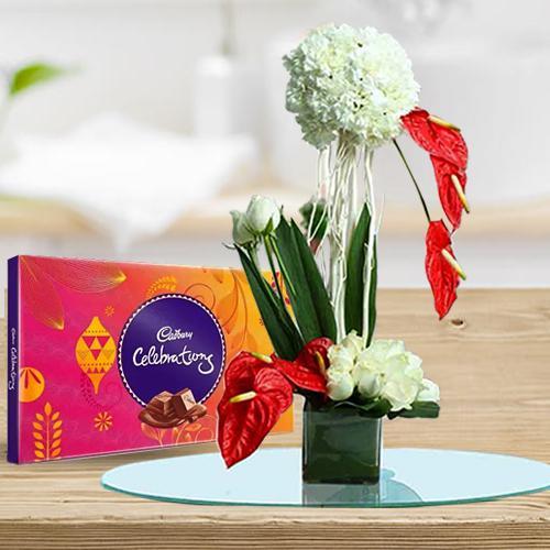 Ravishing Arrangement of Flowers in Glass Vase with Cadbury Celebration