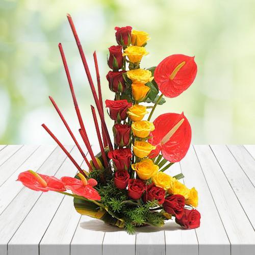 Captivating Red N Yellow Roses N Anthurium Arrangement