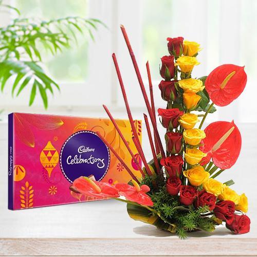 Amusing Anthurium N Roses Arrangement with Cadbury Celebration