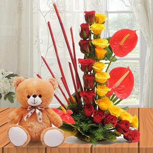 Exquisite Roses N Anthurium Arrangement with a Soft Teddy