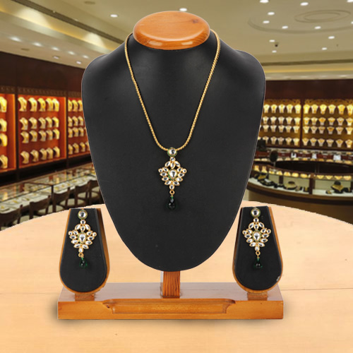 Marvelous Avon Nistha Kundan Pendant and Earrings Set