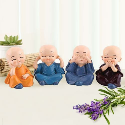 Delightful Set of 4 Buddha Monks Figurines