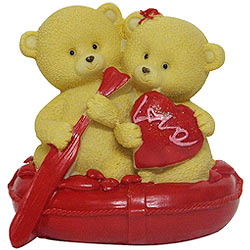 Remarkable Twin Teddy in a Boat
